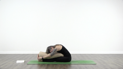 Lauren matters is practising yoga on a green yoga mat