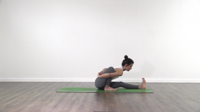 Ashtanga vinyasa yoga seated forward fold with bind